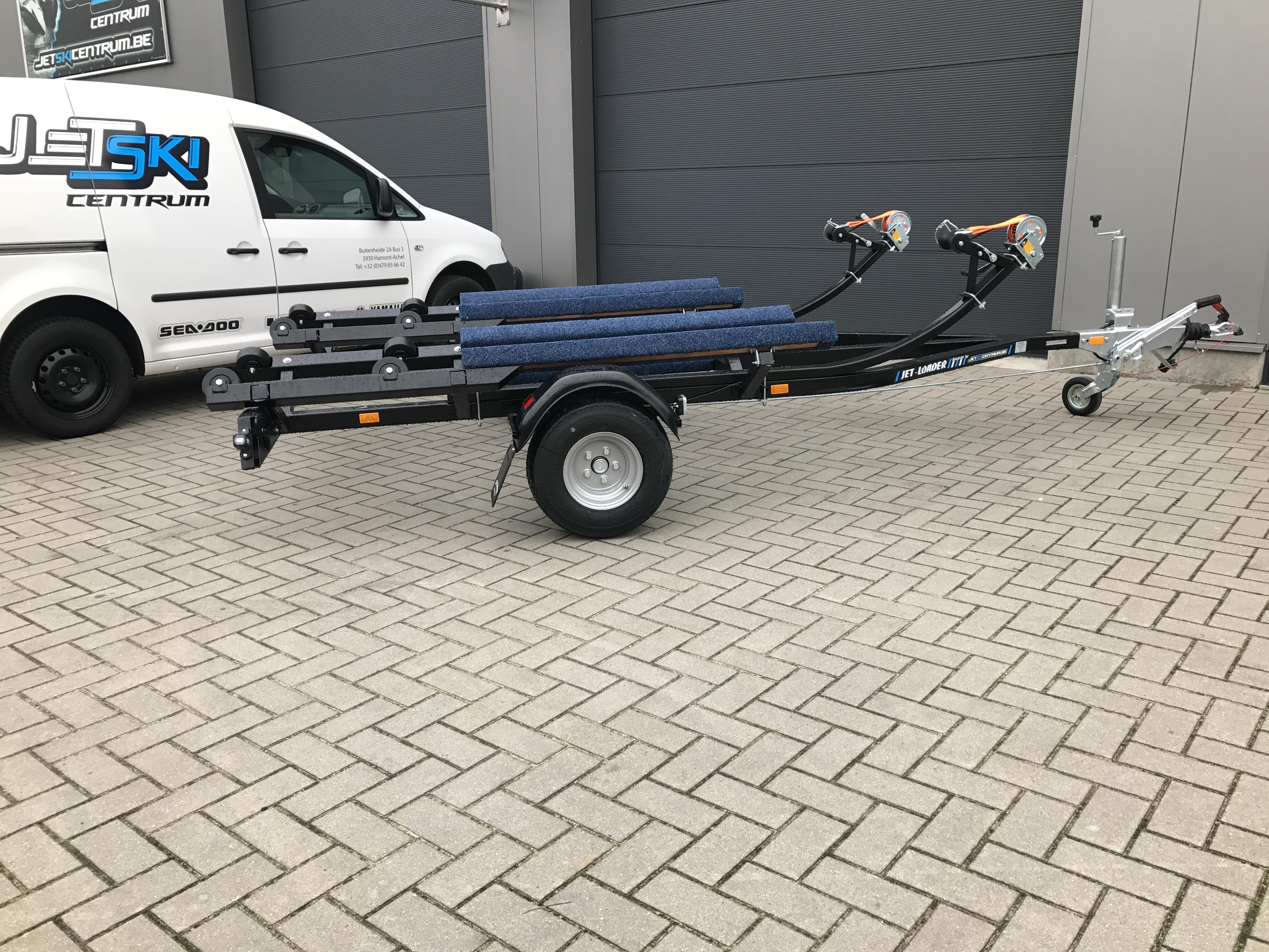 Dubbele jet-loader rolsysteem geremd Image